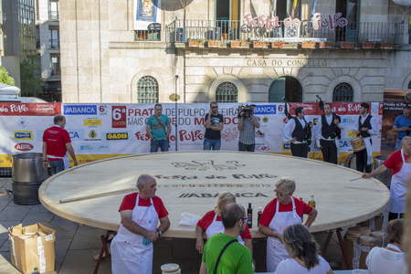 August 4, 2015: Gastronomic party: pulpeiros elaborate the largest octopus cap in the world, a guiness record. Editorial