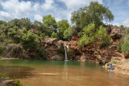 Small natural Waterfall Pego do inferno in Tavira at the Algarve Portugal