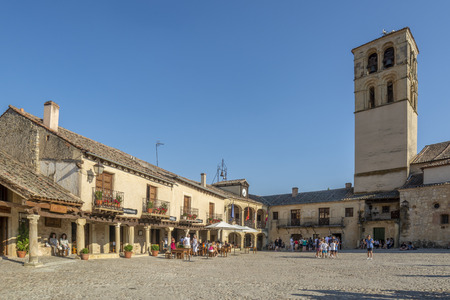 Pedraza, Segovia, Spain; July 2015 : Tourists in the main square of Pedraza one summer day