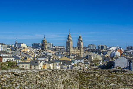 Lugo, Galicia, Spain, April 2015 : Cathedral towers protruding from the walled town of Lugo