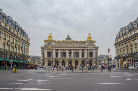 Paris, France, September 2014: Wide angle view of the facade of the Palais Garnier operates house from across the street. Place de lOpera of Paris Editorial