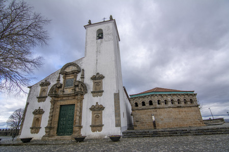View of the St Mary of the Assumption Church in Baroque style and the Domus municipalis Romanesque building, located in the historic centre of Braganca,