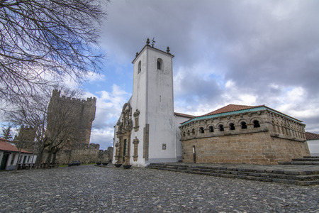 View of the St Mary of the Assumption Church in Baroque style and the Domus municipalis Romanesque building anda castle , located in the historic centre of Braganca, Portugal