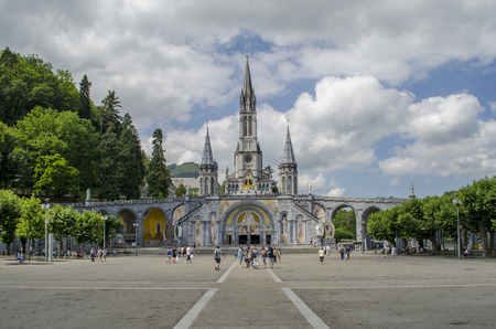 Lourdes, France; August 2013: Loudes famous french town for pilgrimages to the cathedral of the madonna among the mountains of the Pyrenees of France Editorial
