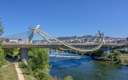 Orense, Galicia, Spain; September 2018: millennium bridge over the river mi as it passes through the city of orense
