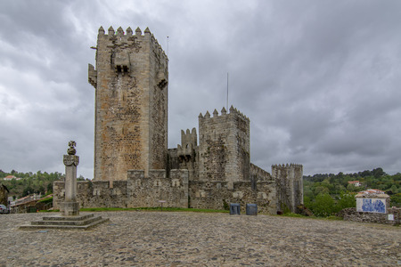 Sabugal castle seen from the square in a cloudy day of spring  in Sabugal, Portugal.