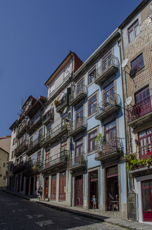 Porto, Portugal - August  2014: Streets of Porto with typical small houses in the city center. Редакционное