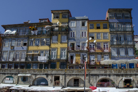 Porto, Portugal; August 2014: Houses of Ribeira Square located in the historical center of Porto, Portugal along the river Duoro.