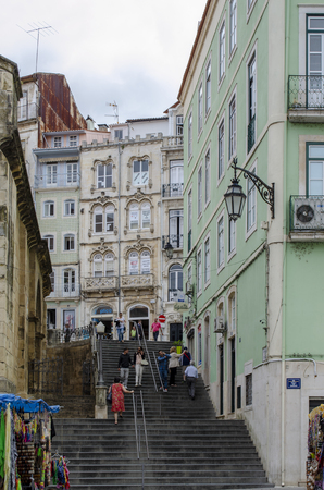 Coimbra, Portugal - July  2014: Narrow street of the Historic center of Coimbra Редакционное