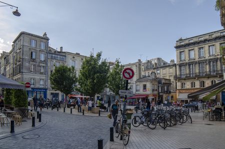 Bordeaux, Aquitaine, France; September 2014: Locals and tourists eating and drinking on a terrace on the Fernand Lafargue Place in Bordeaux Редакционное