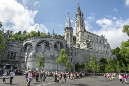 Lourdes, Midi-Pyr?n?es, France; June 2015: The Basilica of Our Lady of Immaculate Conception of Lourdes is built on the top of the rock above the Grotto Редакционное
