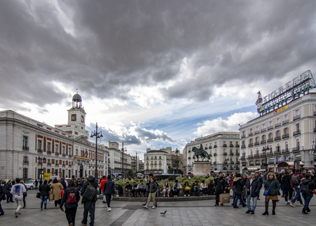 Madrid Spain; November 2018: Tourists in the Square of  Puerta del Sol in the historic center of Madrid Editorial