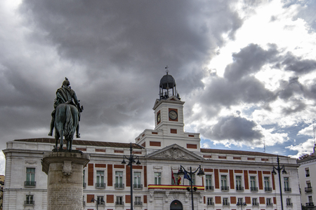 Madrid Spain; November 2018: Post Office and the equestrian statue of Carlos III in Plaza Puerta del Sol in Madrid