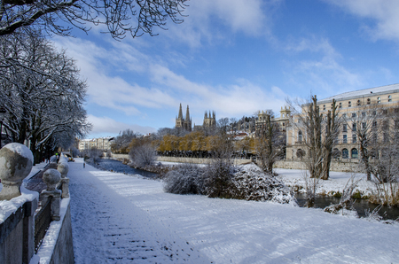 Winter scene of a snowed cityscape landscape of the historic center of Burgos Stock Photo