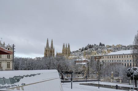 Winter scene of a snowed cityscape landscape of the center historic of city of Burgos , Spain