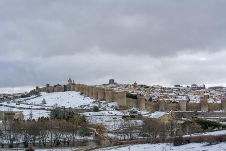 Winter scene of a snowed cityscape landscape of the center historic of city of Avila, Spain