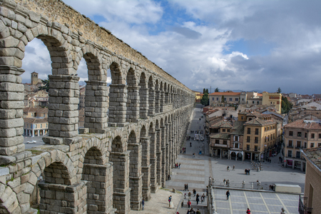 Segovia, Spain: March 2015: Scenery of the Acueduct of Segovia, top view of Plaza Azoguejo and old building towns in Segovia
