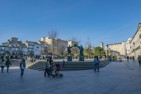 Lugo, Galicia, Spain; April 2015: Stairs and commemorative sculpture of access to the main square of Lugo city