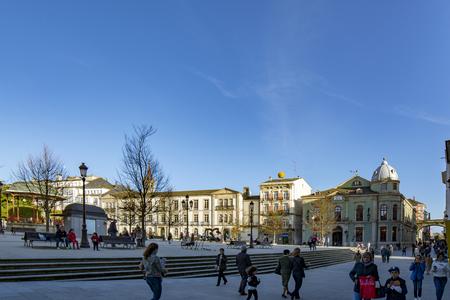 Lugo, Galicia, Spain; April 2015: Tourists strolling along The Main Square Of Lugo.