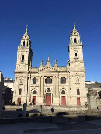 Lugo, Galicia, Spain; April 2015: Facade of the Cathedral of Santa Maria that holds the privilege of the permanent exhibition of the Blessed Sacrament in Lugo