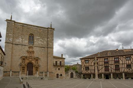 Penaranda de Duero, Burgos, Spain  April 2015: Main Square of Penaranda de Duero with its typical half-timbered houses and church  in province of Burgos, Spain