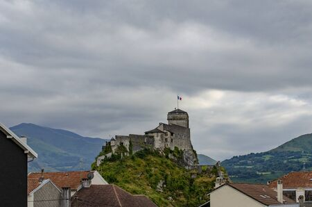 An ancient castle dominates on the green rock above the famous town Lourdes. This is a historical monument keeping the long story of the town of Lourdes