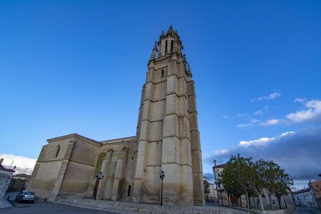 Ampudia, Palencia, Spain; February 2107: landmark facade of Collegiate of Saint Michael, gothic renaissance monument from eleventh to sixteenth century, in Ampudia village