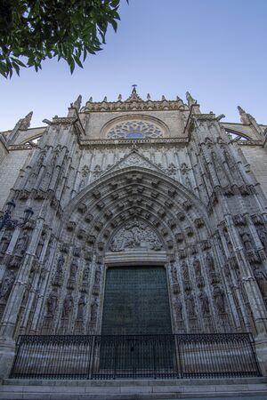 Seville, Spain; July 2107: door of Assumption of the Seville Cathedral