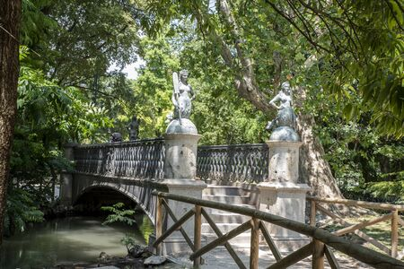 Bridge Mermaids in the park Sempione. The bridge is decorated with four statues depicting mermaids with oars. Sempione Park is adjacent to the Sforza Castle