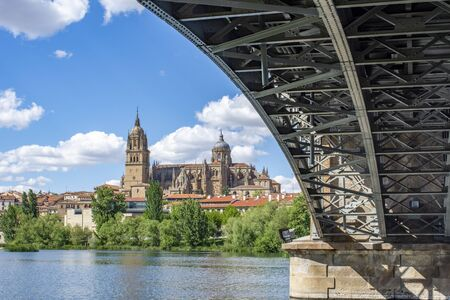 View at the bridge over the river rio Tornes with the cathedral of Salamanca. The old city of Salamanca is an Unesco World Heritage site.