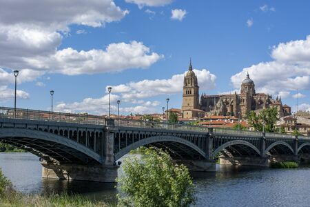 Beautiful panoramic view of the historic city of Salamanca with Rio Tormes and New Cathedral from Enrique Esteban bridge in autumn, Castilla y Leon region, Spain Stock Photo