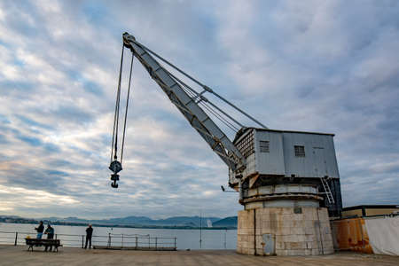 Santander, Spain; September, 2017: View of the old crane called Stone Crane on the seafront in Santander