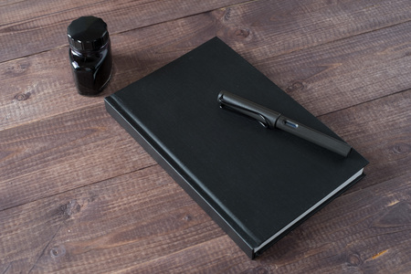 Fountain Pen, Notebook, Ink on wooden table