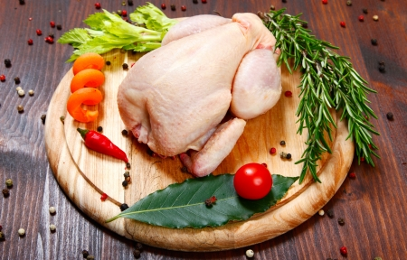 uncooked -raw - chicken with vegetables Stock Photo