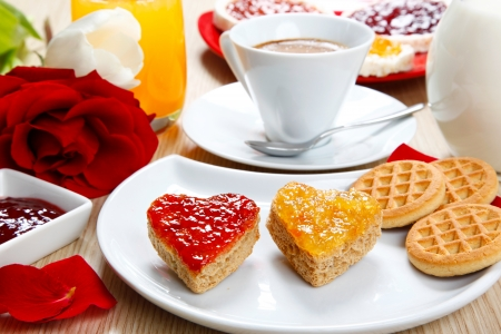 a sweet breackfast with love and red hearths of jam photo