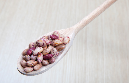 beans on a wooden spoon