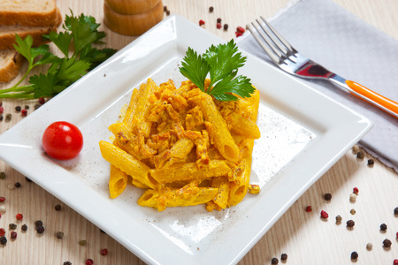 speck: Penne with speck and saffron on a dish