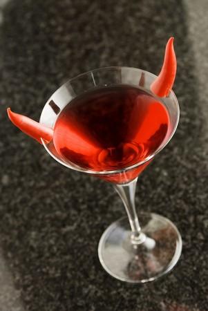 spicey: Rossi martini cocktail con decorazione di pepe