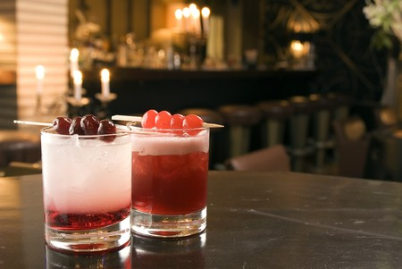 soporific: Two coktails with Gin and Sherry, decoradet with cherries Stock Photo