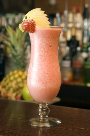 longdrink: Strawberry Longdrink in a hurricaneglass with decoration of strawberry Stock Photo