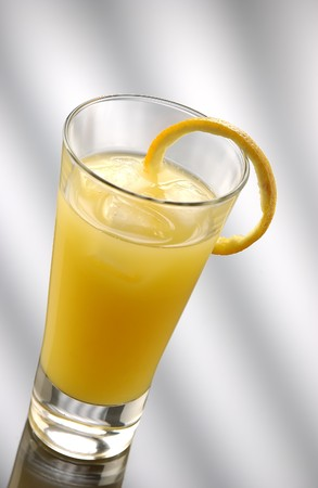 soporific: Gin with orange juice in a collins glass with a orange paring