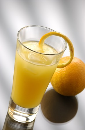 soporific: Gin with orange in a collins glass with a orange paring Stock Photo