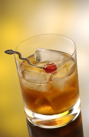 Whiskey on therocks in a old fashioned glass with a cherry photo