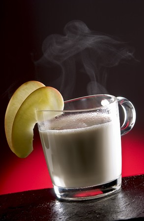 intoxicating: Jean Gabin cocktail with steam and a slice of apple Stock Photo