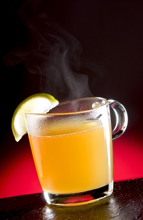 Martins Rum with steam and a slice of lemo photo