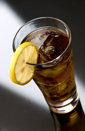 Long Island Ice Tea with a slice of lemon Stock Photo - 7170677