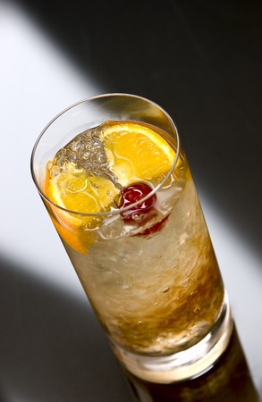 intoxicating: Prince of Wales cocktail with crushed ice, orange and cherry