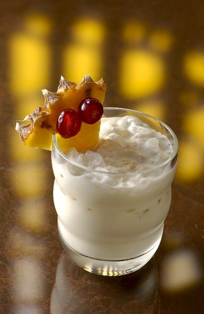 intoxicating: White Bahia Drink with red currant and a piece of pineapple