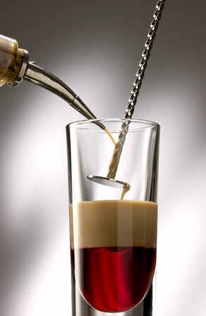 cocktail mixer: Pour liquid layer into a long drink glass.