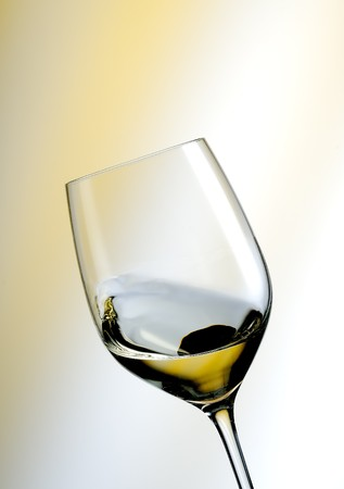 soporific: A Glass of white wine in an yellow ambiance Stock Photo